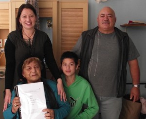 Saana Murray receives the Wai 262 report with four generations of her whanau